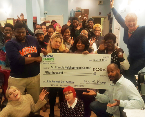 Photo of St. Francis Neighborhood Center receiving check from The 7th Annual Royal Farms Charity Golf Classic.